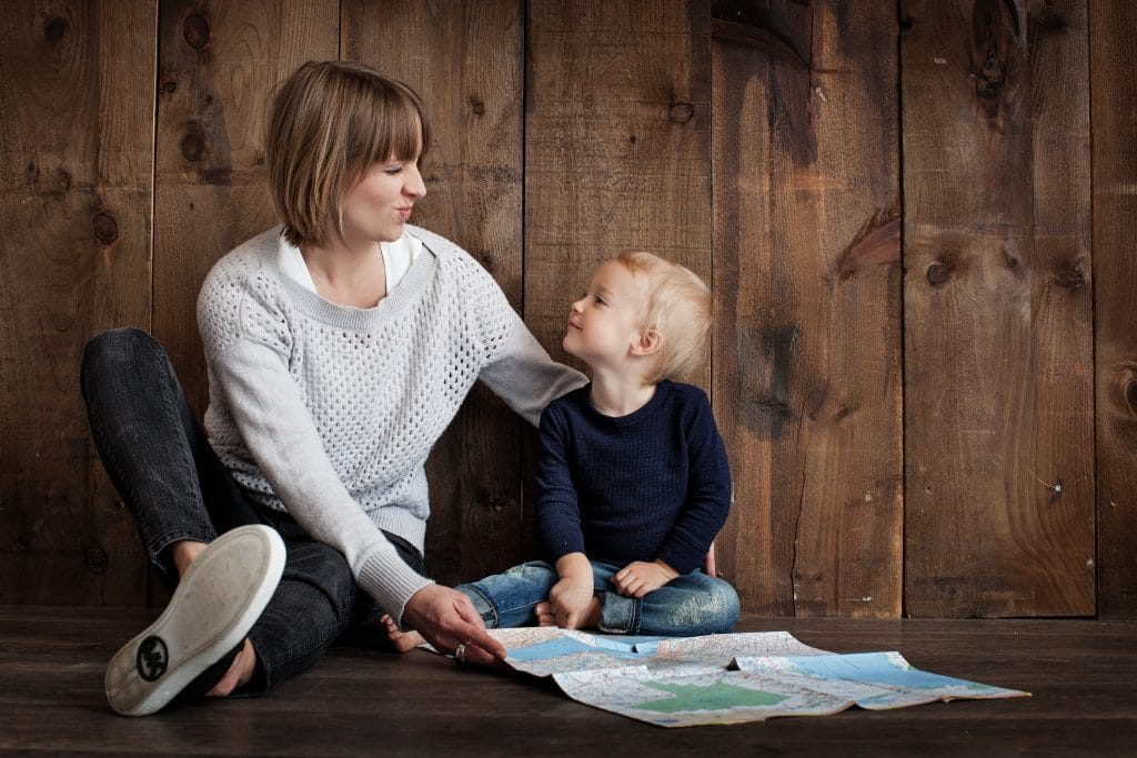 Canva Child With Woman Holding Map