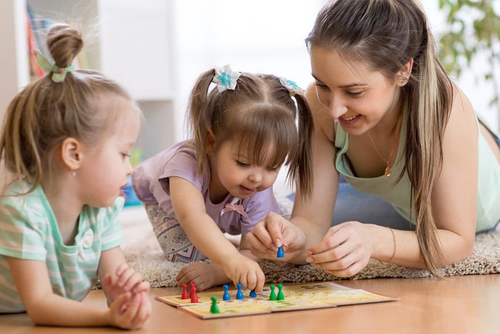 Nannies Playing Board Games